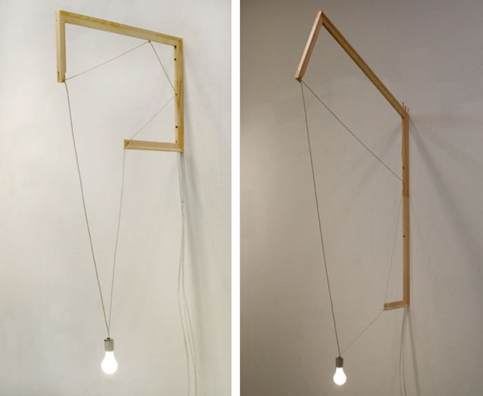 Rappaport's wall-mounted designs feature wood stretcher bars, light bulbs, and electrical wire. Contact the James Fuentes Gallery for pricing.