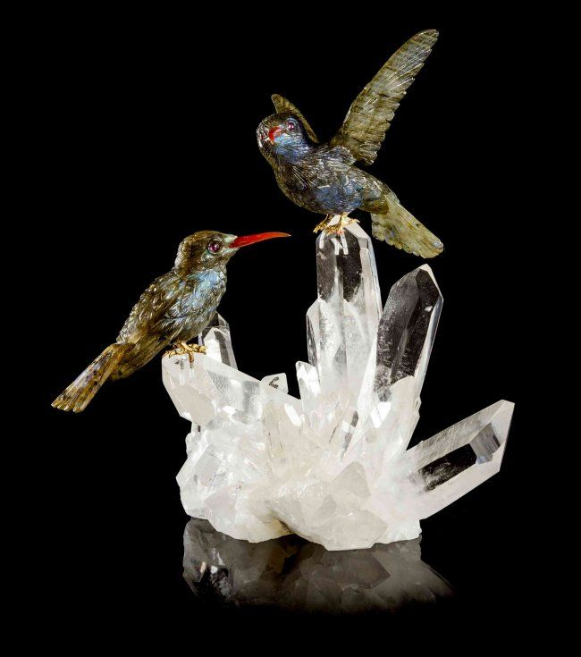 A labradorite agate and amethyst hummingbird carving