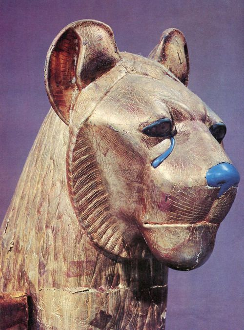 The head of a funerary couch in the form of a cheetah with tears falling from his eyes.  Book: Tutankhamen's Treasures