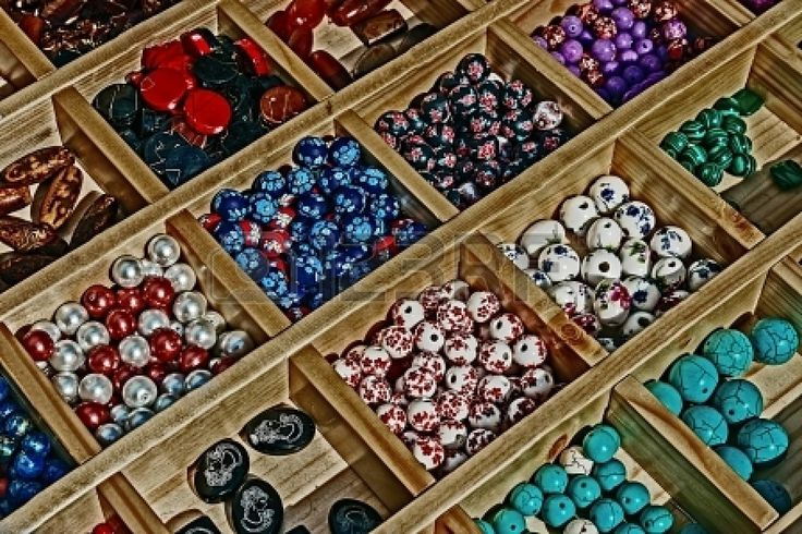 I have recent sales at 123RF Colored beads with different shapes, presented in a wooden box divided