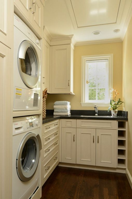 Compact laundry room withe natural lighting.  #laundryrooms homechanneltv.com