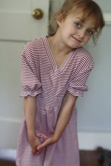 Shirred T-shirt cover-up. Re-fashion this cute little girl's dress from a big kid's t-shirt.  Posted by Jessica Christman on Factory Direct Craft Blog.