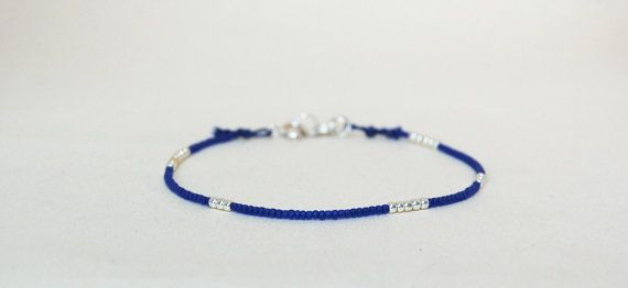 Clear blue beaded bracelet with silver colored seed by AasJewelry