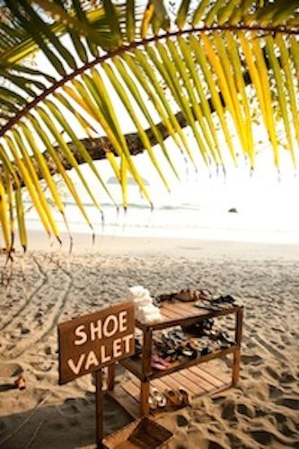 Shoe Valet. . .allow guests to check their shoes and pick them up at the end of the event, along with a pre-moistened towel to wash the sand off their feet. This way your friends and family can put their shoes on and go home sand-free!