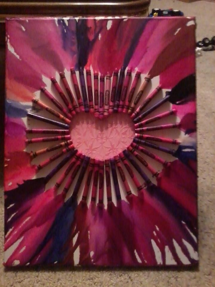 1.get fairly good size canvas so your crayons have room to drip. 2. cut out size of heart you want with scrap book paper. 3. glue heart down and start outlining the heart with the bottom end of crayons. i used super glue to make sure they stayed. 4. takeblow dryer and start melting. turn the canvas while you melt so your drips go the direction you want them to go.  5. HAVE FUN! I DID!