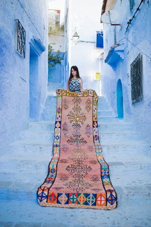THIS is her site where you can buy the beautiful Moroccan Rugs!