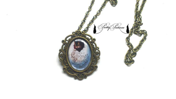 "necklace with an illustration ""cat in an egg"" from Pretty Pretiosa for cat lovers"
