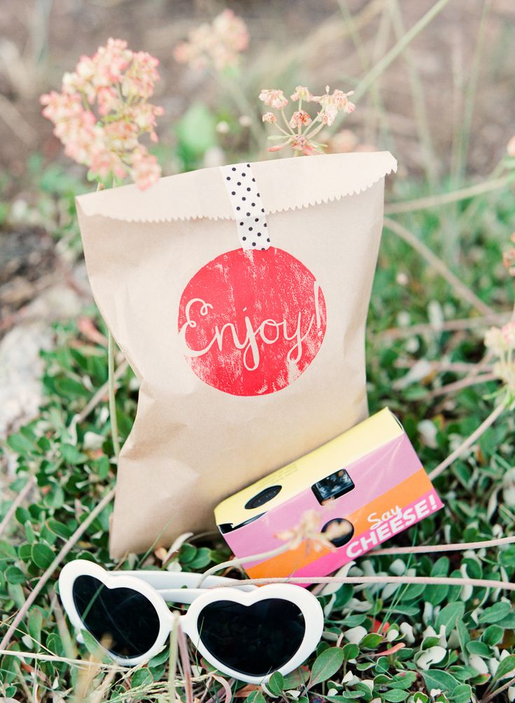a favor bag filled with heart sunglasses and a camera for snapshots of the festivities