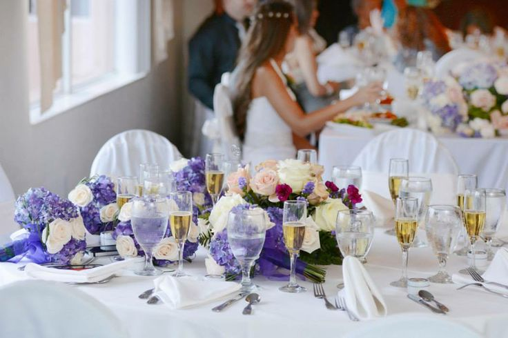 The bridal party's table during the reception wedding photo