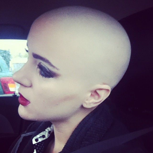 Girls head shaved smooth