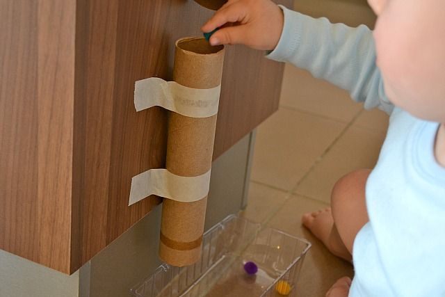 Putting pom-pom into cardboard tube and 4 other easy Montessori activities