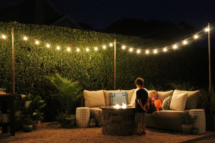 String up some lights between poles to add a romantic glow to your backyard.