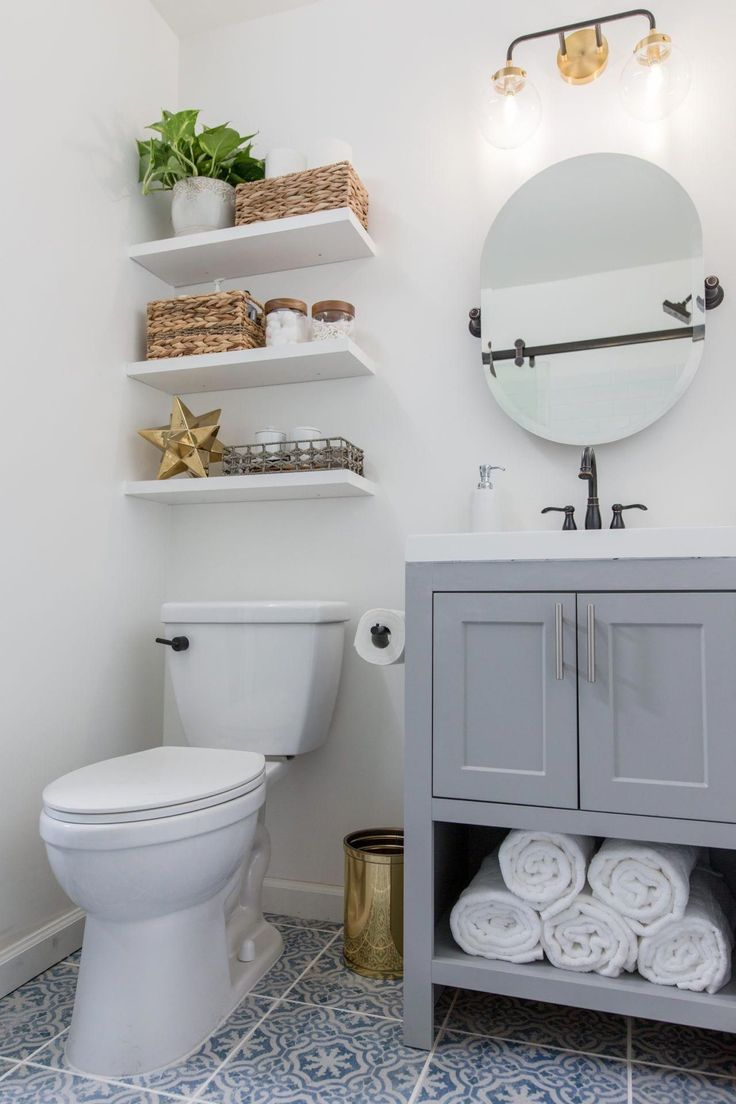 Most bathrooms are short on storage, so installing floating shelves above the to…   – Contemporary Bathroom Wall Lights