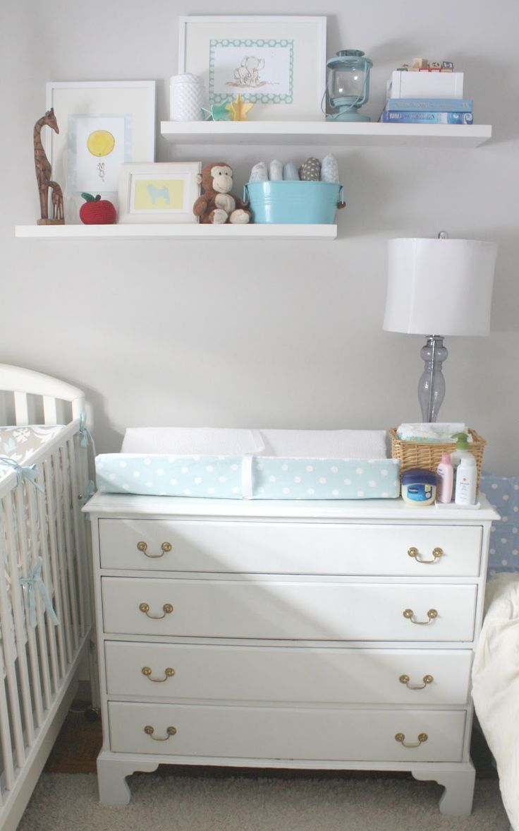 Could place dresser next to crib, then chair and tall piece together on other small wall