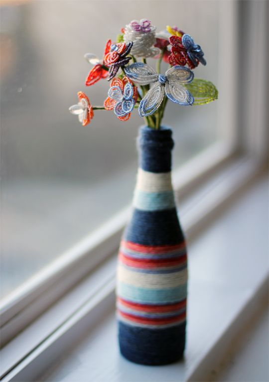 cool vase, with added bonus of needing an empty bottle :) Inside My Hideaway: DIY Yarn-Wrapped Bottle Vase