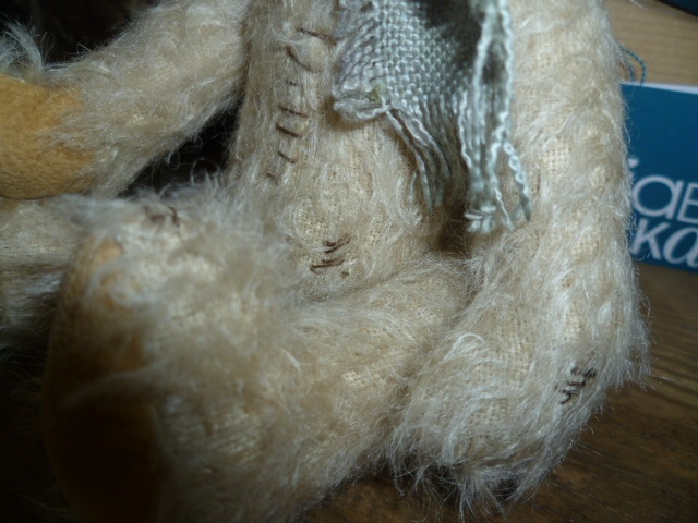 A close up of 'Erbert' showing the hand stitched detailing, which makes him unique to the 'scruffy' bear collection.