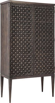 ED™ Ellen DeGeneres Oletha Tribal Door Chest   The ED Ellen DeGeneres Oletha Tribal Door Chest is one-of-a-kind. Elegance and superior craftsmanship sets this chest apart. Ellen's love of details is evident from the pierced tribal door carvings in cast resin to the interior light kit. Two wood frame adjustable glass shelves, mirrored inside back, one stationary shelf and three soft-closing drawers. Finish is dark fumed oak.