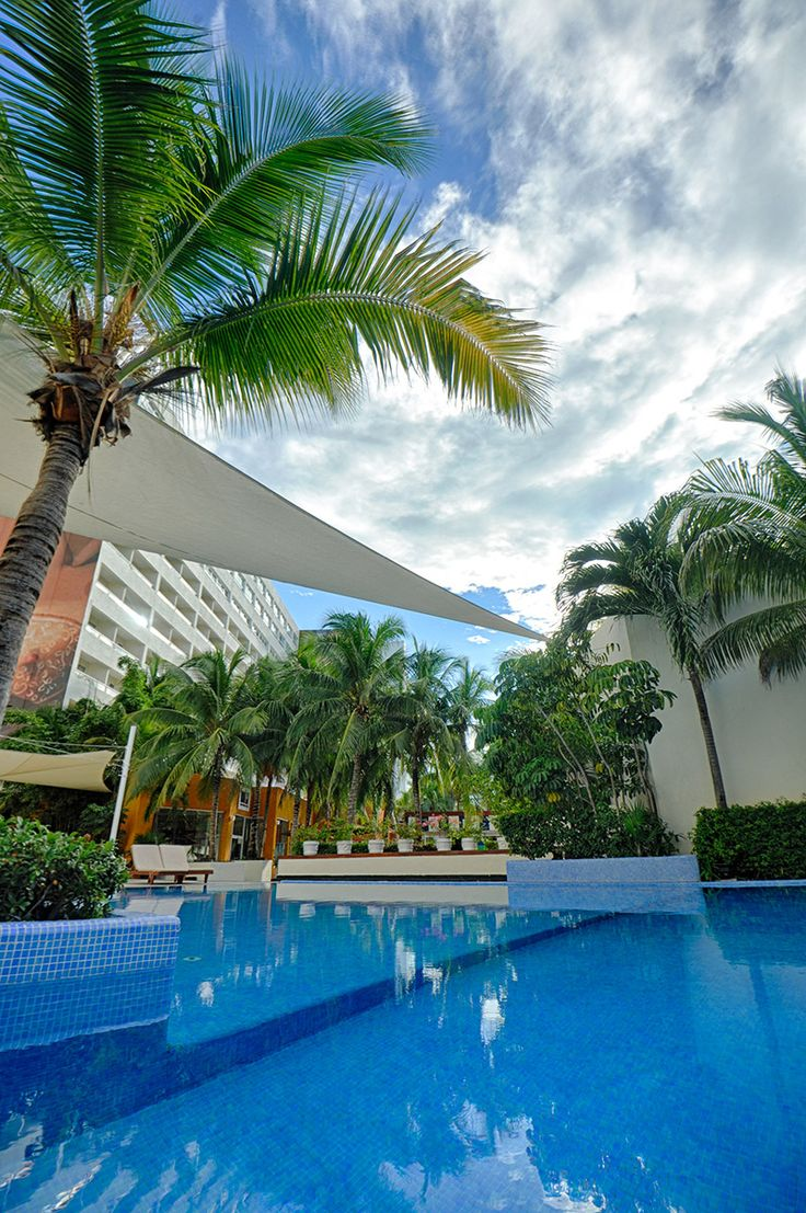 Relax poolside at Dreams Sands Cancun Resort