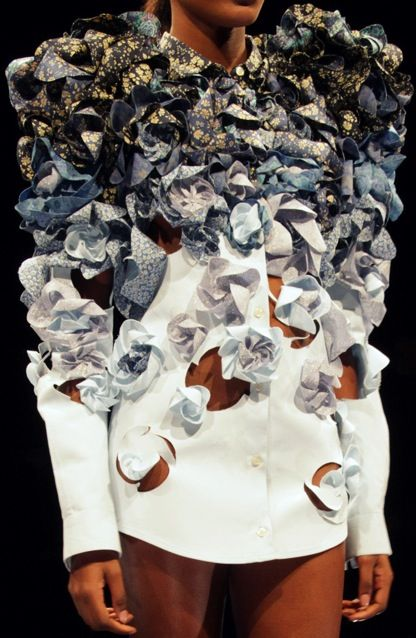 Maison Martin Margiela I really like this shirt, because it looks like paper flowers stuck onto the shirt. fading from a dark blue to white making it monochrome but with the flowers attached it is still not too simple.