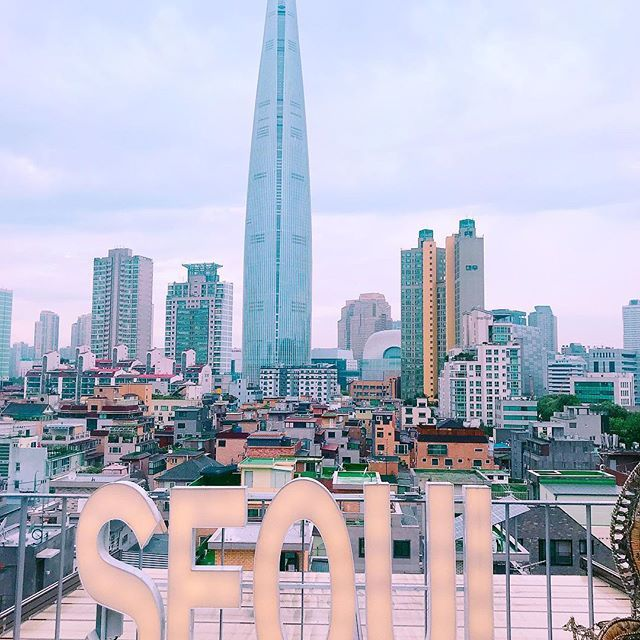 Seoulism Perfect Spot In Jamsil Wonderful View Over Lotte World Tower The Seoul Sign On The Terrace Of The Cafe Seoul Travel Lotte World Seoul Cafe