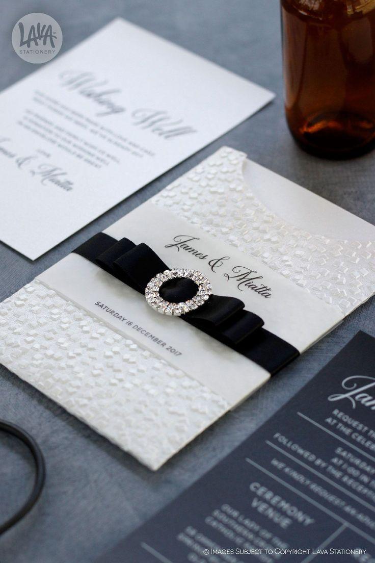 "At last, Miatta and James' invitations! These were customised from the traditional ""Modina"" range into more modern black and white colours.   •••  #weddingbling #diamantebuckle #swarovskicrystal #embossedpaper #designerpaper #pocketinvitation #pocketinvitations #pocketinvite #rsvpcard #wishingwell #wishingwellcard #rsvppostcard #designedinaustralia #realwedding #handmadeinaustralia #goldcoastwedding #lavastationery #whiteinkprinting  #traditionalinvitation  #classicinvitations"