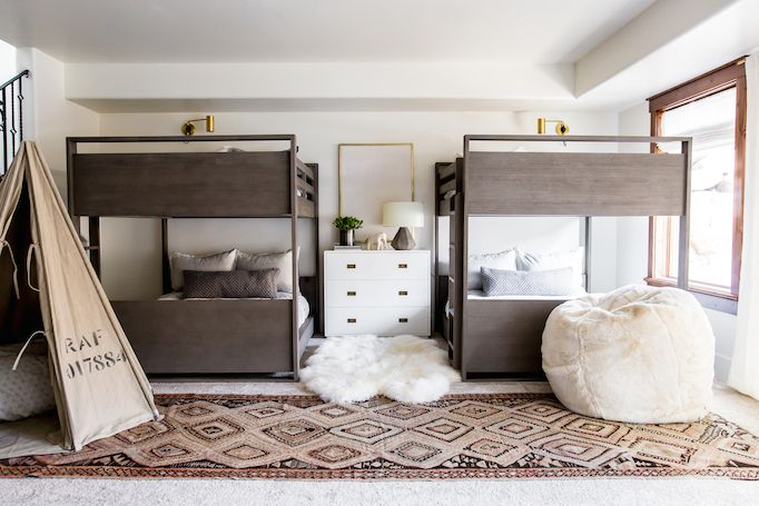 BECKI OWENS-- Modern Bunk Room. A kid-friendly, cozy space with layers of warm neutrals, rustic wood, Benjamin Moore Swiss Coffee paint and brass accents.