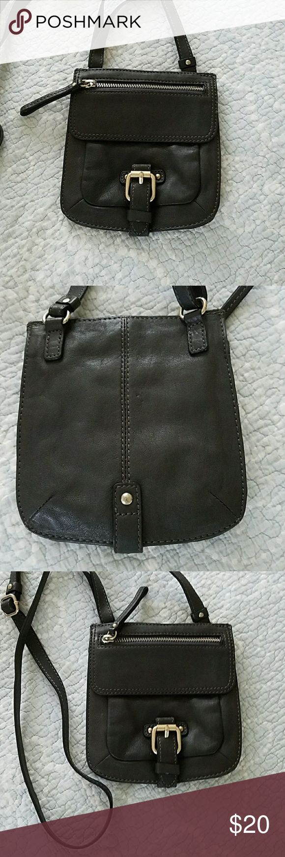Banana Republic purse Banana Republic mini charcoal gray genuine leather purse. Approximately 6 inches wide by 7 inches high. Used once or twice in excellent condition. Perfect for small amounts of personal items like lipstick cell phone and small wallets. Smoke-free home. Remember to bundle with other items for an even better deal! Banana Republic Bags