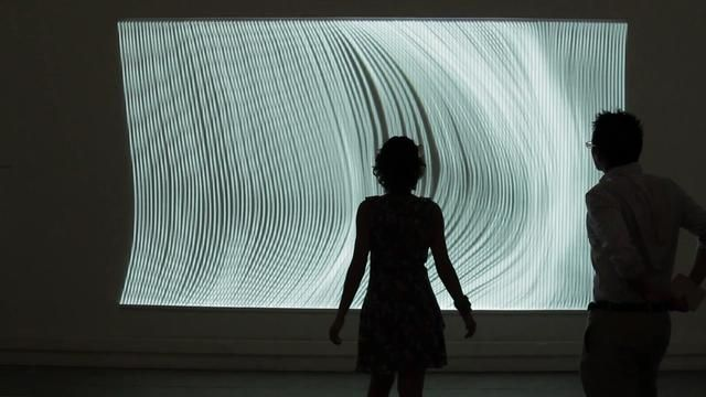 This is honestly astonishing. It's called, Nervous Structure (field) (2012). Video by Cristobal Mendoza. The depth of  interaction is phenomenal...the viewer is the reason the projection moves.