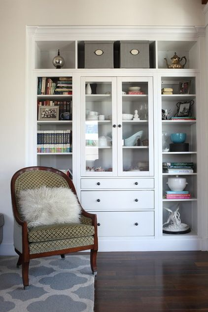 """After splurging on a built-in for the master bedroom, Larson was looking for a less expensive way to add a built-in to the great room. This one began life as a cabinet from Ikea. """"We found bookshelves that would fit and then had a custom unit made to go across the top. So it is part custom and part Ikea,"""" says Larson. """"We are very happy with it in the end."""""""