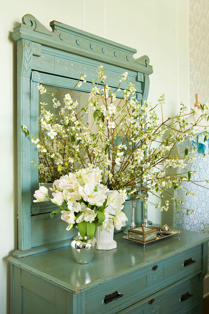 """A trademark of shabby chic décor is utilizing furniture in spaces they aren't traditionally meant for. This large turquoise dresser makes a great entryway piece…with plenty of """"hidden"""" storage."""