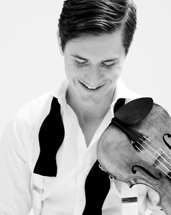Violinist Charlie Siem -- although we can't quite see his face, the spirit is here, as well as the connection to his instrument.  Nice approach.
