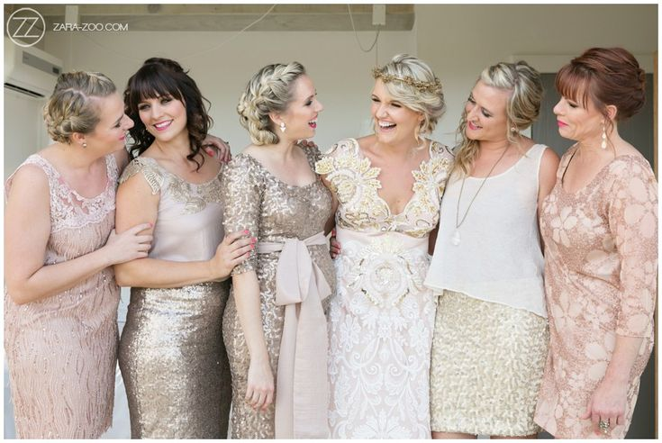 Bridesmaid dresses, each bridesmaid wearing a different style complementing the overall colors and look, blush pink, cream and gold. Designed by Alana van Heerden.