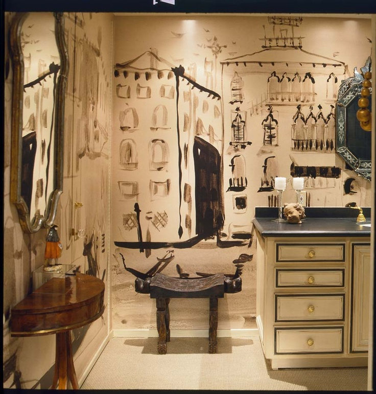 """DESIGNER HUTTON WILKINSON, CREATED THIS """"VENETIAN"""" POWDER ROOM, BEHIND A HIDDEN DOOR IN A LOS ANGELES APARTMENT BY LINING THE WALLS WITH ENLARGED MURALS OF ORIGINAL TONY DUQUETTE PEN AND INK DRAWINGS OF VENICE.  THERE ARE TWO HIDDEN DOORS BEHIND THE MURAL ON THE LEFT HAND WALL."""