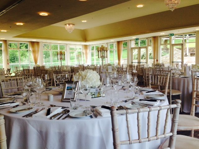 White wedding with limewashed chiavari chairs and white hydrangea centerpieces