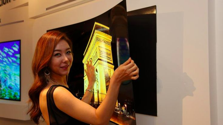 LG's 55-inch 'wallpaper' OLED display hangs on the wall with magnets