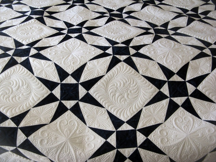nothing simple looking about this black and white quilt ...  nothing simple ...