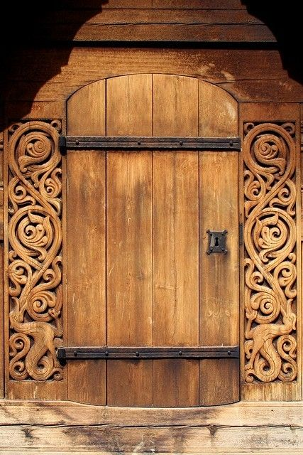 Beautiful wood carved door maybe an entrance to a wine cellar