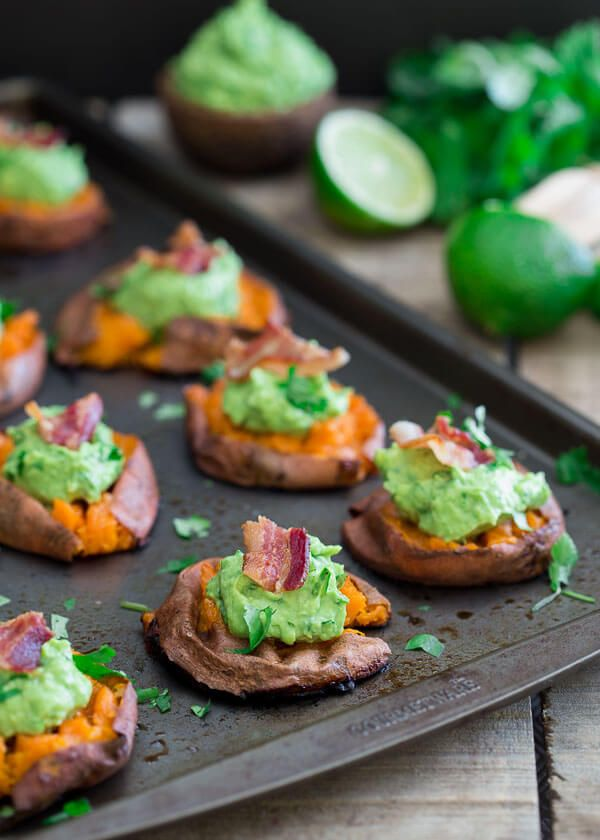 Smashed sweet potato guacamole bites. The perfect healthy bite for the Super Bowl!