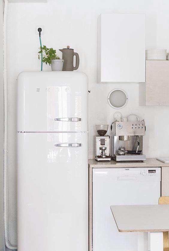 white fridge in kitchen. white refrigerator bright kitchen fridge in n