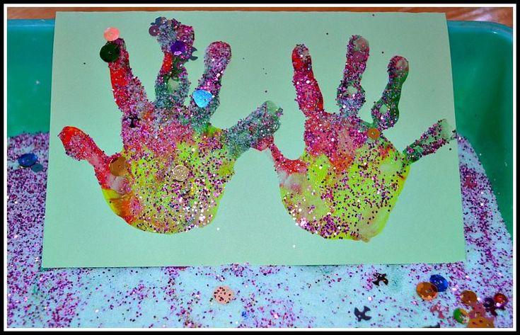 rainbow hand prints with salt glitter as christmas cards