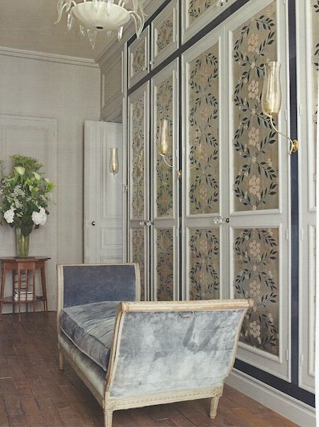 wallpaper paneled doors, chaise in front of cupboards