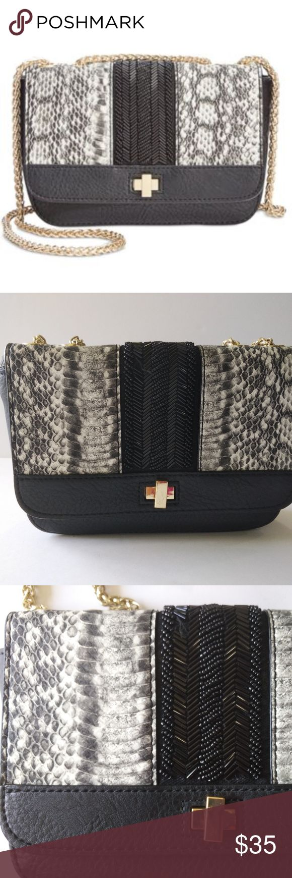 """NWT International Concepts Mariin Crossbody Black Be the envy of the event with INC International Concepts' stunning faux-leather crossbody, appointed with a sumptuous mix of beaded and metallic chain details.  7-5/8""""W x 4-7/8""""H x 2-1/8""""D Interior features lining and 1 slip pocket; fits an iPhone 6 plus or smaller 23""""L adjustable crossbody chain strap Turn-lock closure Exterior features gold-tone hardware and beaded embellishment Faux leather Some beads missing, photo shows INC International…"""