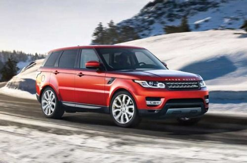 2015 Range Rover Sport in Firenze Red Driving in Snow