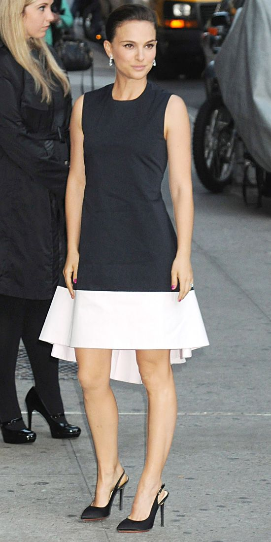 Natalie Portman hit The Late Show with David Letterman in a dark blue Christian Dior dress with a white asymmetrical hemline. She accessorized with Dior slingback pumps