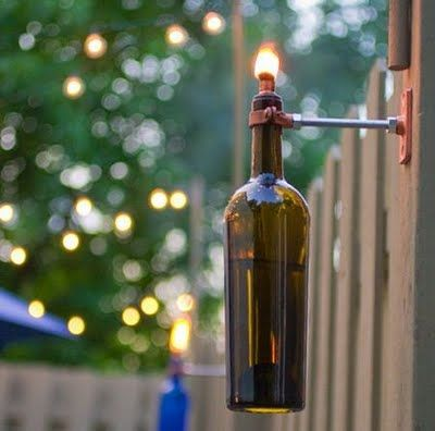 Tiki torch wine bottles. Have to do this on the fence at the Island!: Idea, Oil Lamps, Recycled Wine Bottle, Wine Bottle Torches, Backyard, Wine Bottles, Tiki Torches, Lanterns, Old Wine Bottle