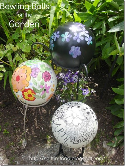 hmmmm bowling balls, baseballs great way to get some inspiration and use out of something the kids do not play with anymore too. Whimsical Garden Balls