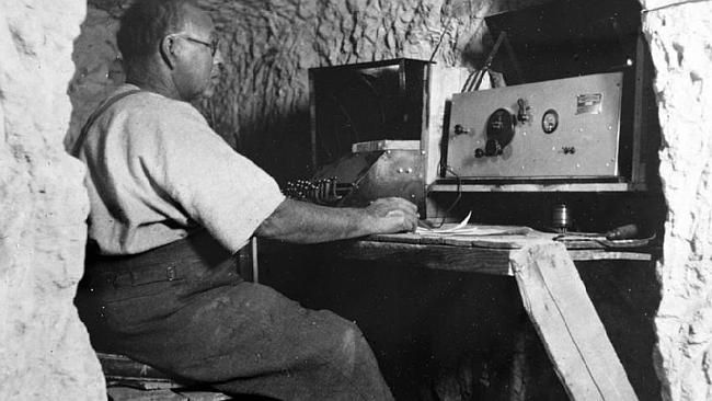 An operator uses a telegraph station at the Coober Pedy post office.