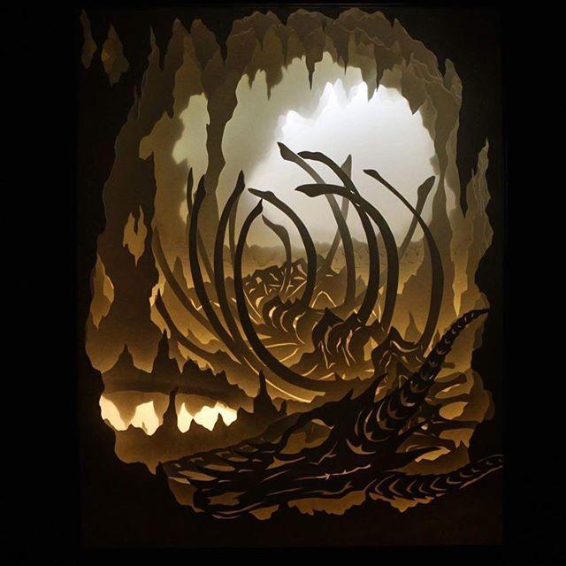 """Wyrm's Rest"" 8x10"" #dreambox #handcut layered paper lit with strip #leds  Edit: SOLD! #dragon #cave #dragonbones #skeleton #bones #fantasy #paperlightbox #papercut #lightbox #shadowbox #paperart #papersculpture"