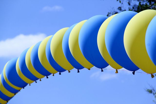 Yellow and Blue Balloons by griffithchris, via Flickr