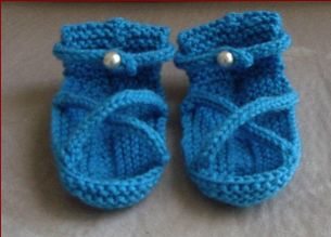 Knitting pattern for 8ply baby sandals with two i-cord foot straps.